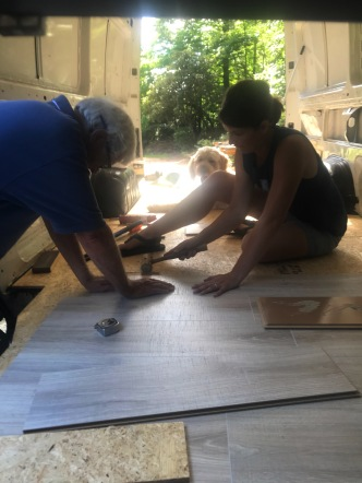 Dad and I laying the flooring